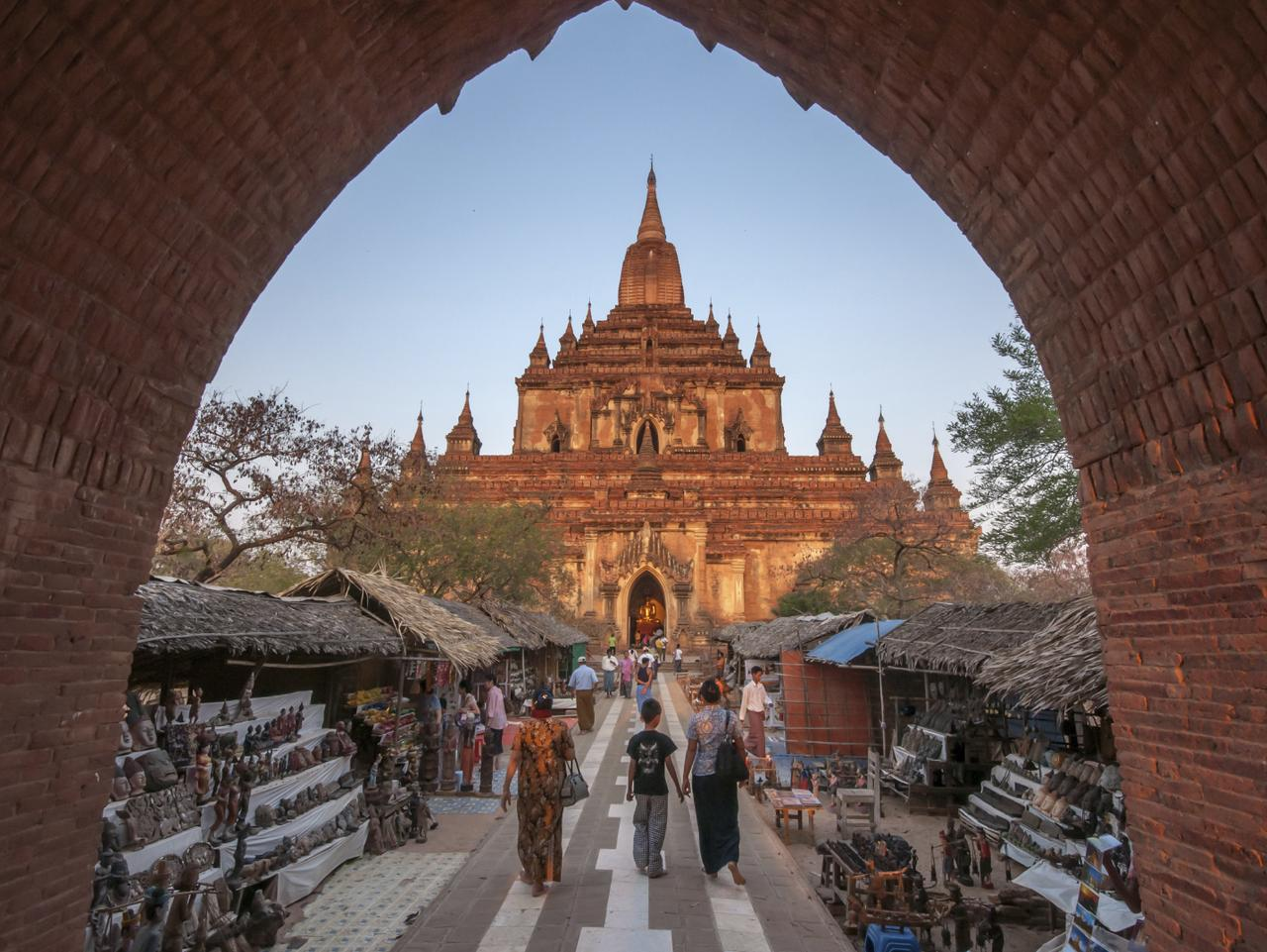 ESCAPE: MYANMAR .. Sarah Nicholson story .. March 19,2011 : Htilominlo Temple entrance with tourist passing by street market to enter the temple in Bagan, Myanmar.This large temple was built by King Nantaungmya in 1218. Situated close to the road between Nyaung U and Bagan. Picture: iStock