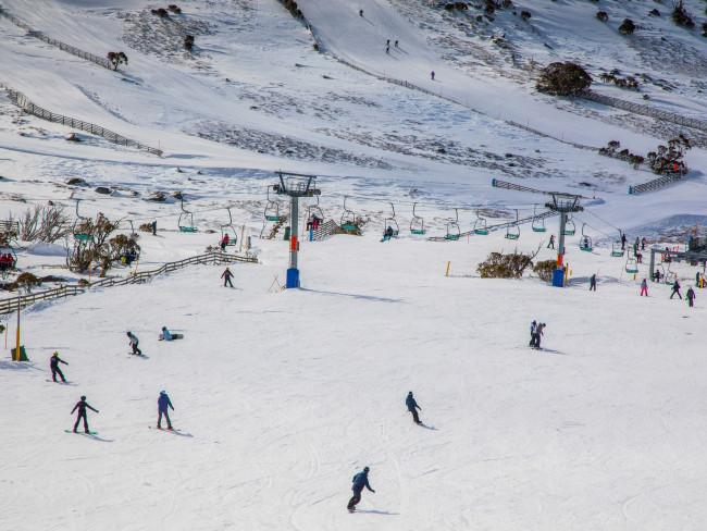 People enjoying a day of skiing and snowboarding at Blue Cow ski resort in Perisher. Picture: Destination NSW