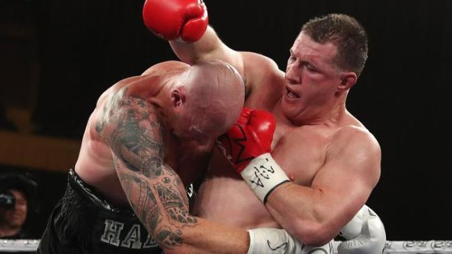Paul Gallen tries to get an uppercut as Barry Hall hangs on to him. Picture: Michael Klein