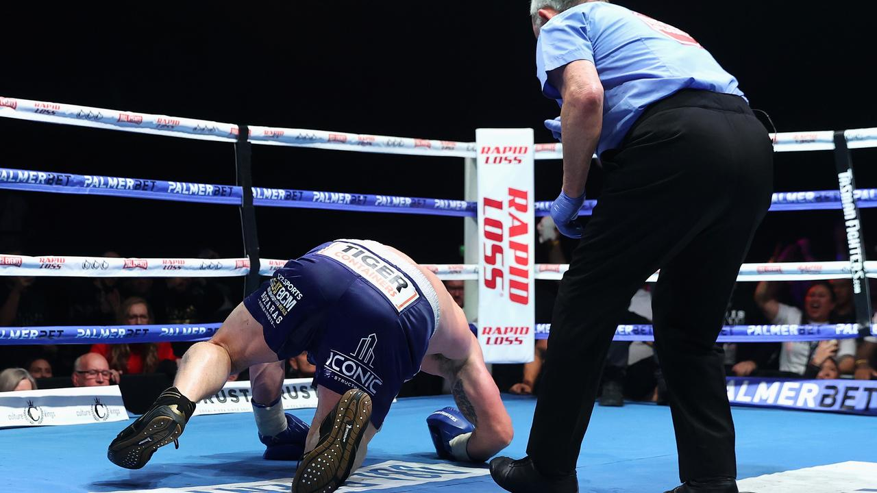 Justis Huni knocks Paul Gallen to the canvas.