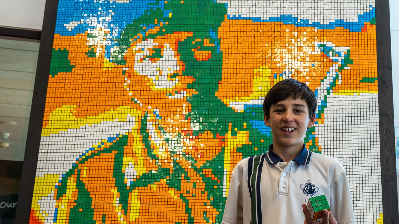 Elijah Lewis with his Peace on Earth mural. Picture: World Vision