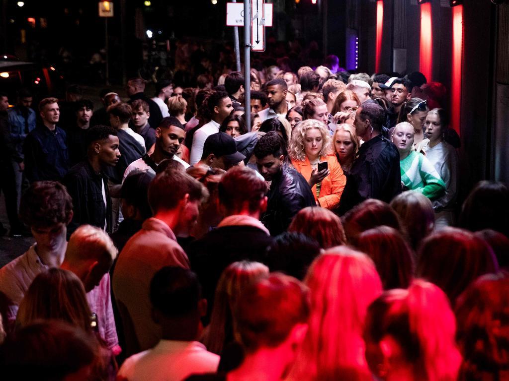 People crowd in front of a nightclub in Copenhagen this week. Picture: Olafur Steinar Gestsson / Ritzau Scanpix / AFP