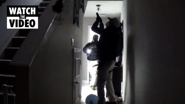 Watch: Former US data scientist posts moment armed police raid her home