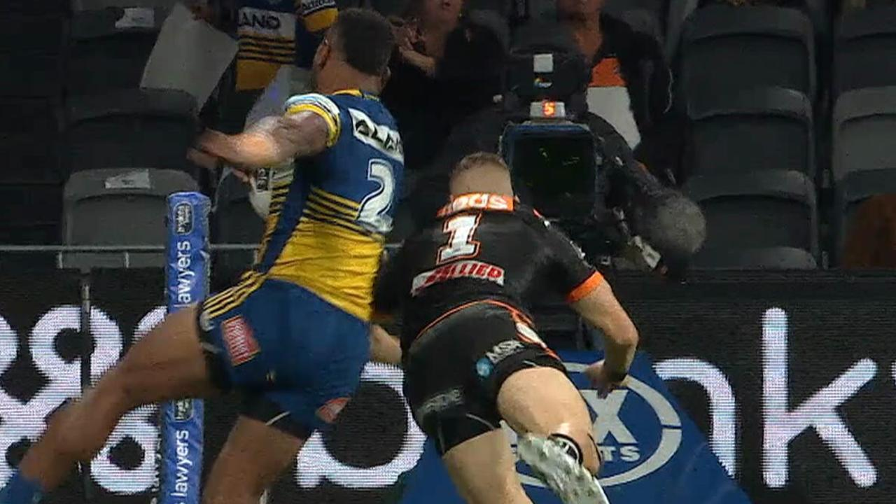 Adam Doueihi shoulder charges Maika Sivo into touch.