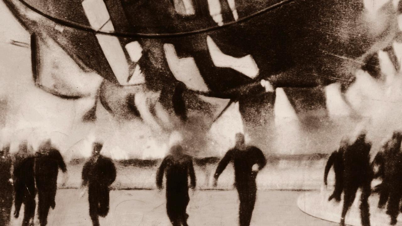 Onlookers running away from the Hindenburg as it crashes to the ground on fire at Lakehurst Naval Air Station in New Jersey, USA 07 May 1937.   zeppelin explosion accident fireball disaster  dirigible  historical  1930s  /Airships