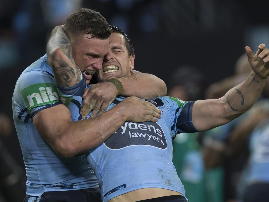 Mitchell Pearce celebrates the winning try.