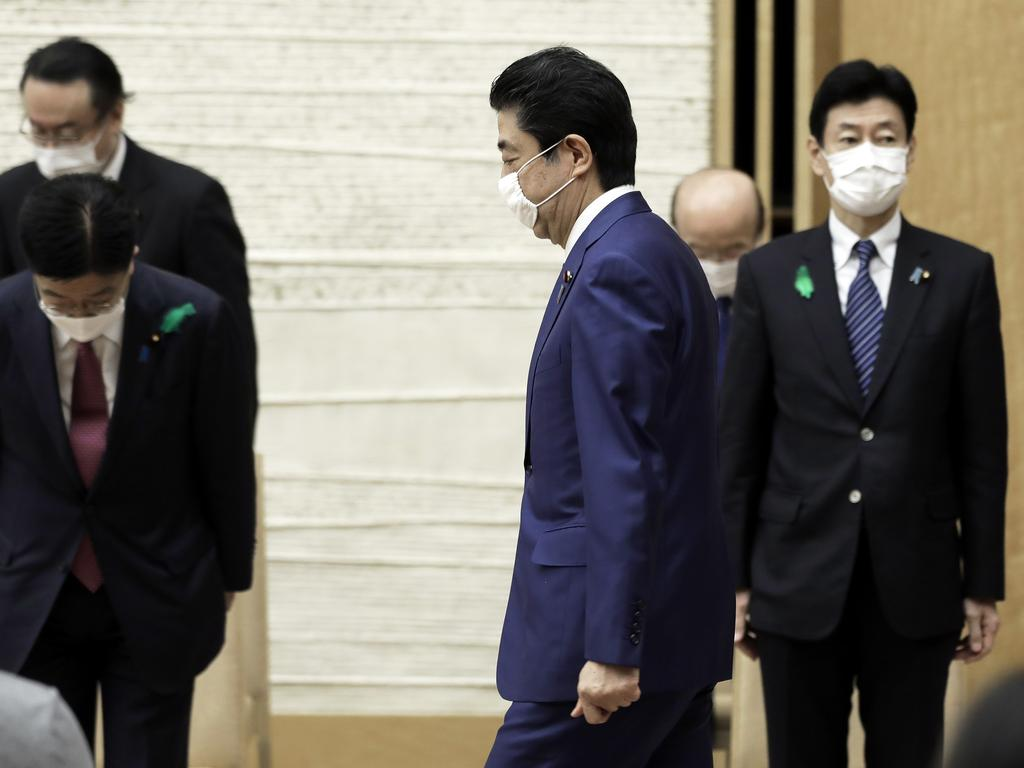 Japan's Prime Minister Shinzo Abe wearing a protective mask as he arrives for a news conference in Tokyo, Japan. Picture: Kiyoshi Ota/Pool Photo via AP