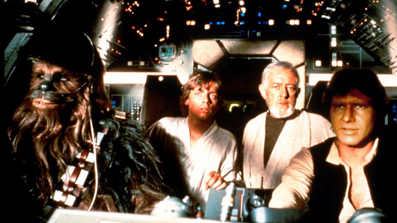 Chewbacca with actors Mark Hamill, Alec Guinness and Harrison Ford in the Millennium Falcon in a scene from Star Wars Trilogy Special Edition films.