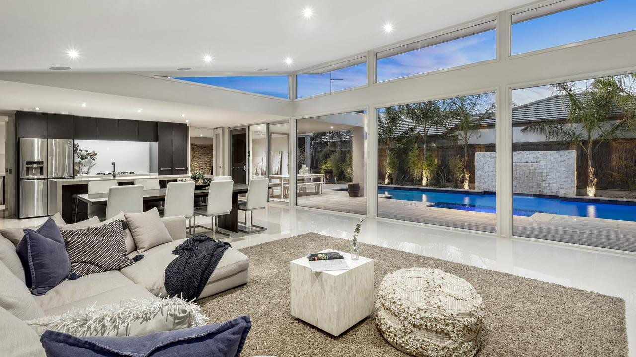 Large windows in the main living area offer a nice outlook to the pool.