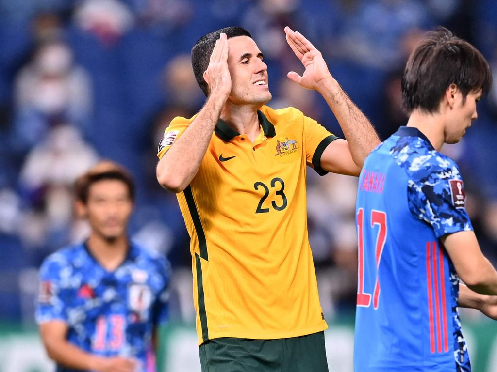 Australia's midfielder Tomas Rogic (2nd-L) reacts after missing an attempt during the 2022 Qatar World Cup Asian Qualifiers group B football match between Japan and Australia, at Saitama Stadium in Saitama, on October 12, 2021. (Photo by CHARLY TRIBALLEAU / AFP)