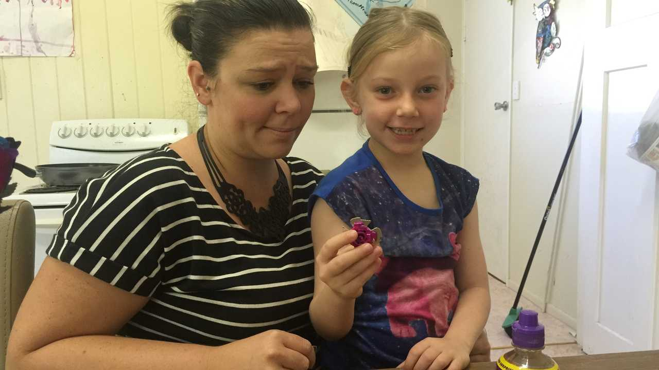 Maryborough mum Rebecca Sutcliffe was a little concerned when her six-year-old found a toy resembling a ninja star in her juice.