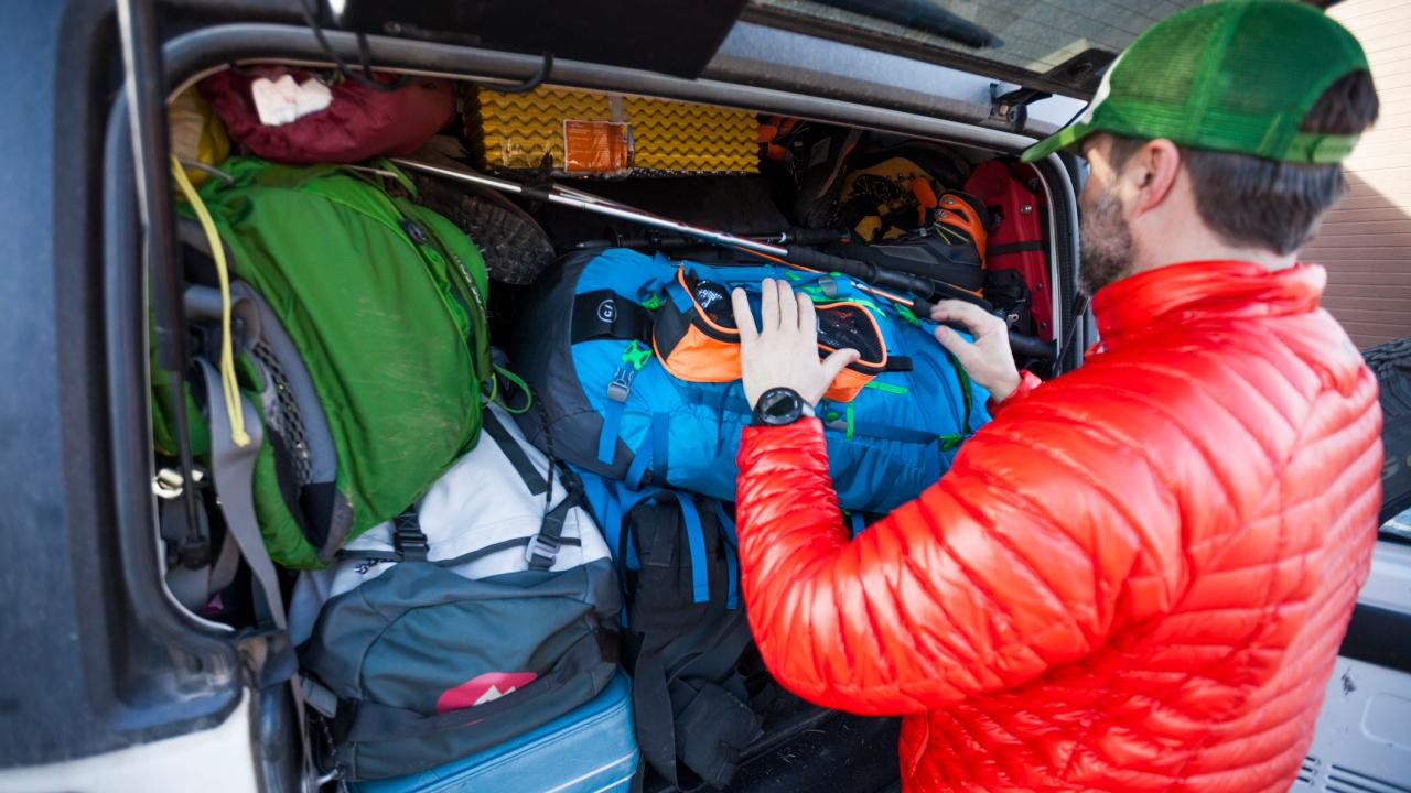 Don't you even think about putting a bag in that car boot. Dad's got this. Picture: Getty