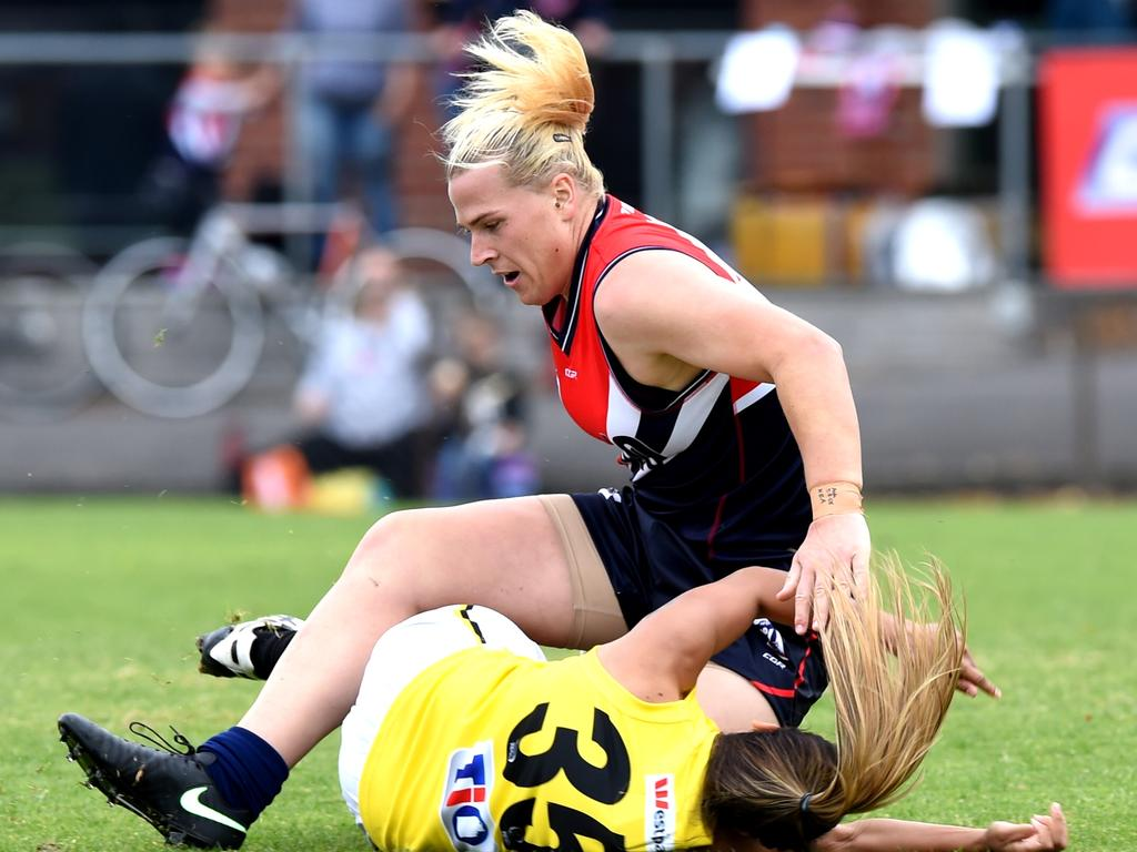 Hannah Mouncey collides with an opponent. Picture: Nicole Garmston