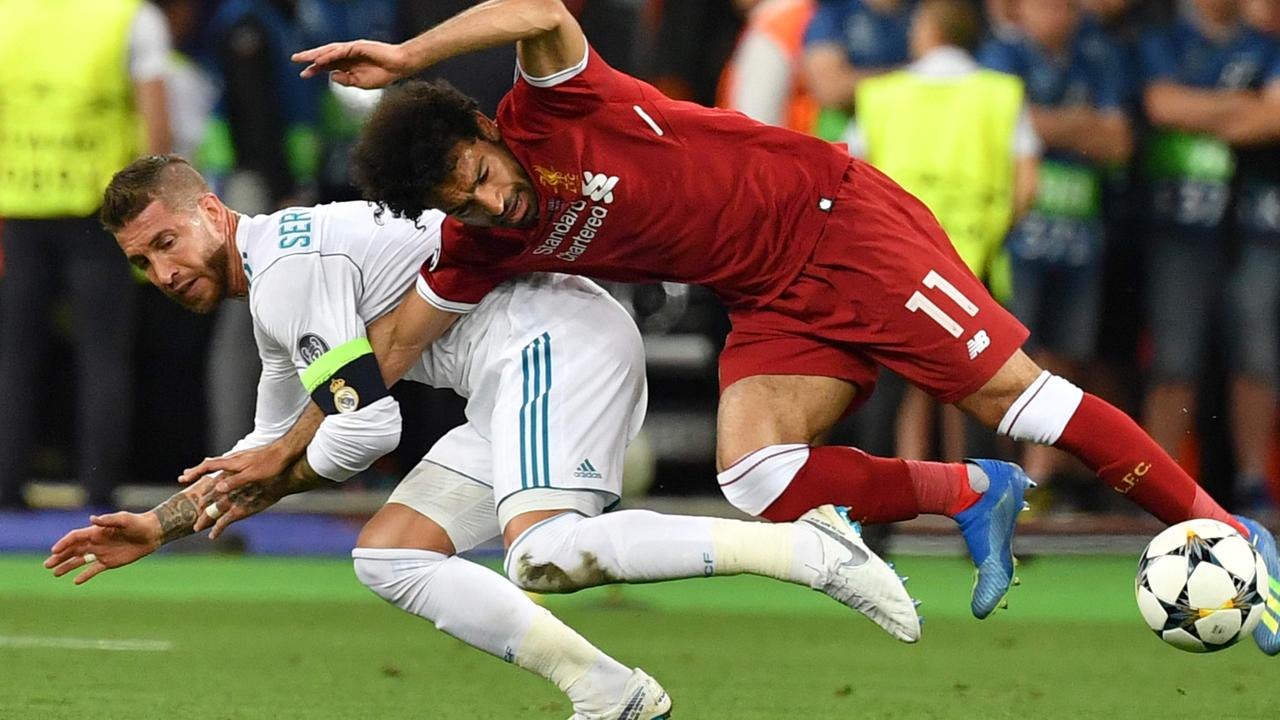 Mohamed Salah is brought crashing down by Sergio Ramos.