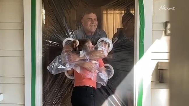 Girl makes 'hug curtain' to hug grandparents