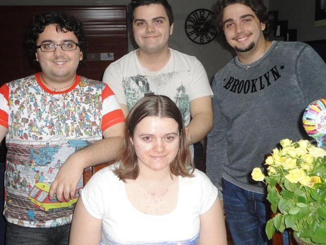 Courtney Topic and her three brothers.