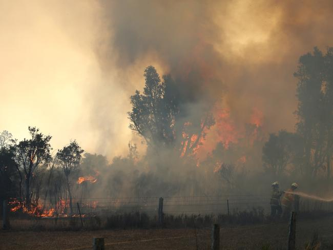 Flames and smoke billowing in the Salt Ash area. Picture: Peter Lorimer
