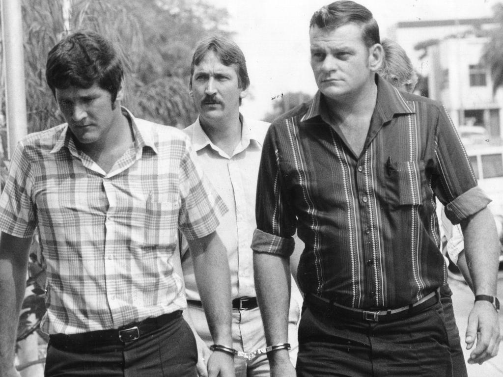 Reginald Arthurell (right) arrives at Alice Springs Magistrates Court in 1981 charged with murdering sailor Ross Browning, 19.
