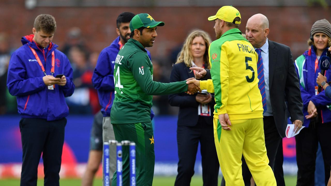 Pakistan's captain Sarfaraz Ahmed shakes hands with Australia's captain Aaron Finch. Photo: Saeed Khan/AFP.