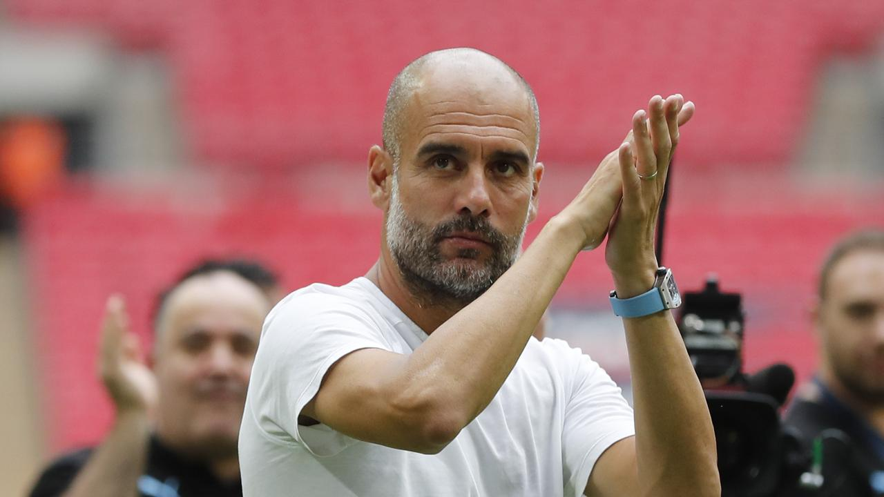Manchester City's manager Pep Guardiola applauds fans after winning the FA Community Shield over Liverpool. (AP Photo/Frank Augstein)