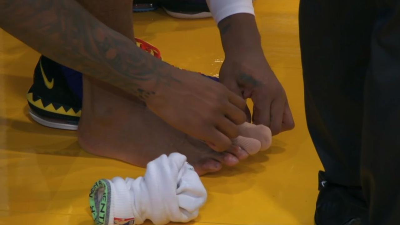 Andre Drummond checks his toe. Source: @BulletClublta