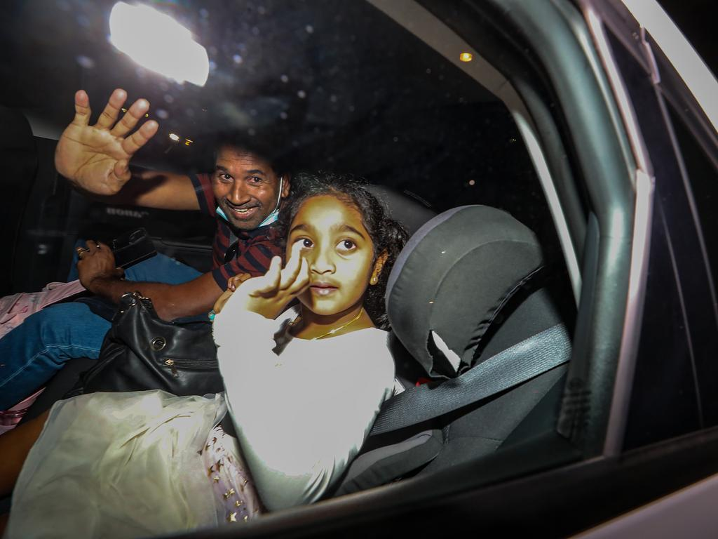 Nades Murugappan and daughter Kopika arrive from Christmas Island to be reunited with his wife and daughter. Picture: Colin Murty/The Australian.