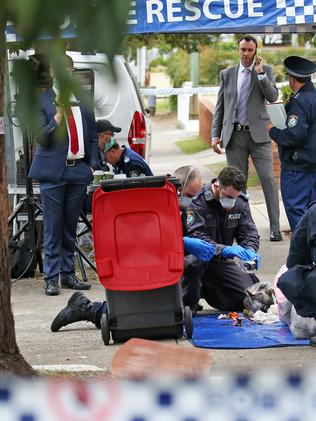 AFP and NSW Police Force teams at a house linked to Mr Khayat. Picture: Toby Zerna