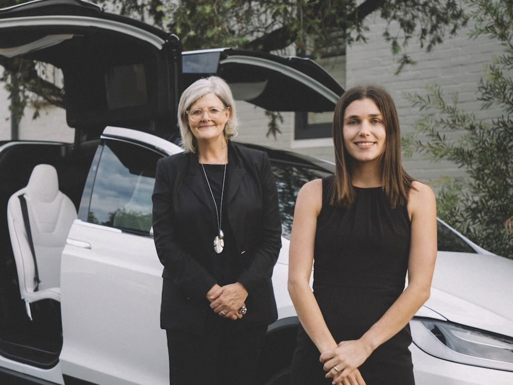 Regular passenger Sam Mostyn (left) with Evoke founder Pia Peterson (right) and a Tesla limousine. Picture: Supplied.