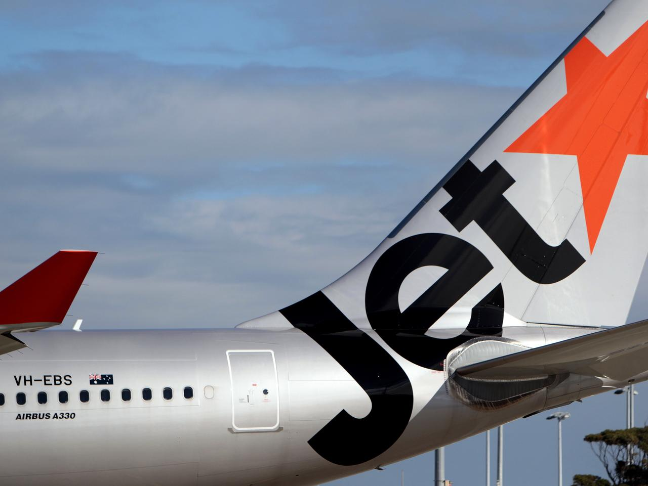 Generic Jetstar aircraft at Sydney airport. Jet star, plane.