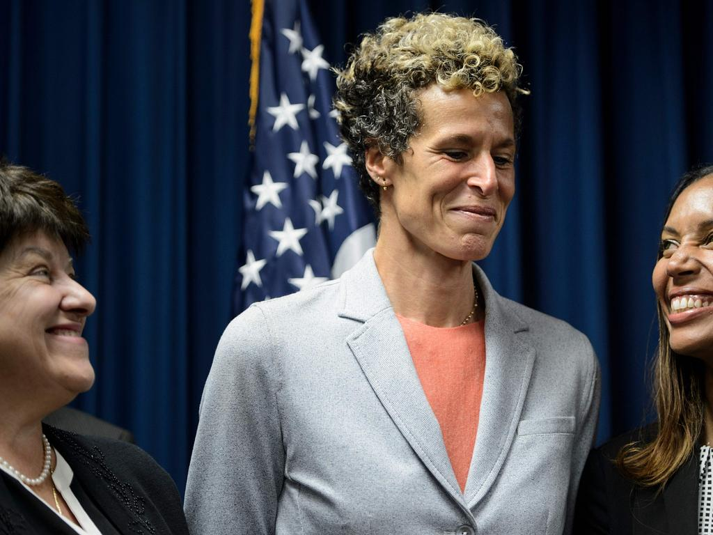 People smile during a press conference with Andrea Constand (C), after the sentencing of the comedian.