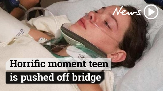 Shocking moment teenage girl gets pushed off a bridge