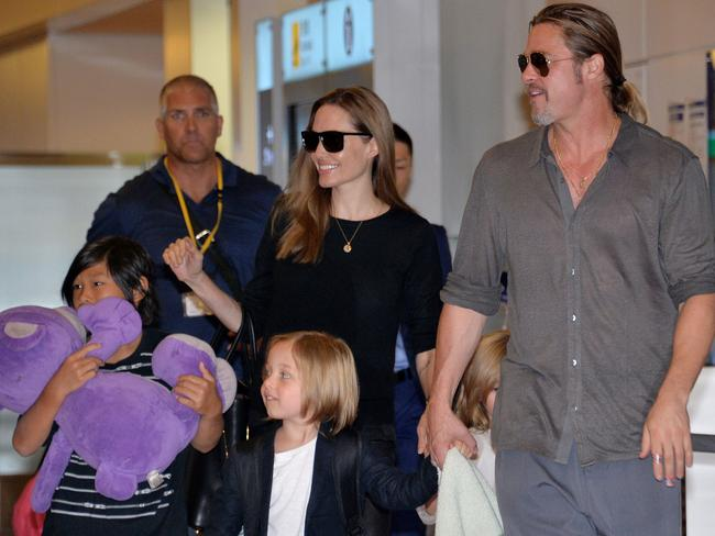 The globetrotting family were frequently pictured at airports. Picture: AFP PHOTO / Yoshikazu TSUNO