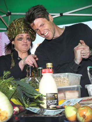 """Jacqui Lambie and Ben Milbourne as the """"mystery box"""" of Tasmanian ingredients is unveiled. Picture: CHRIS KIDD"""