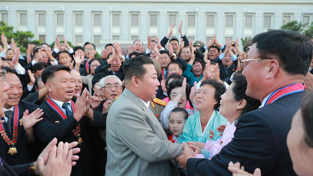 Kim Jong-un meeting with North Korean citizens, with not a mask in sight. Picture: AFP PHOTO/KCNA VIA KNS