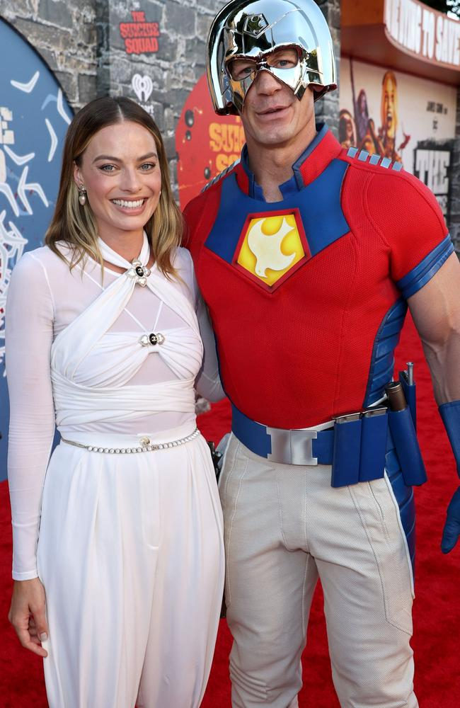 Robbie with her co-star John Cena. Picture: Kevin Winter/Getty Images