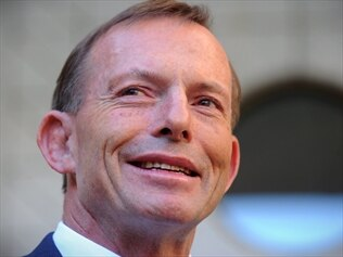 Prime Minister Tony Abbott says his government is still committed to scrapping the carbon tax.