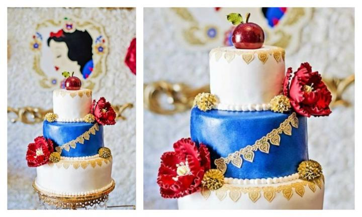 <b>SNOW WHITE.</b>  A glossy red apple is the stunning topper on this princess inspired cake, with delicate gold lace piping draped across the tiers. Large red and gold flowers contrast with the bold blue tier and will have you fighting for a slice - poison or not!<p><I>Source: Natalie Orona Photography</I></p>