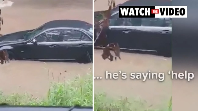 Driver floats away with car in floodwaters (Nine News)