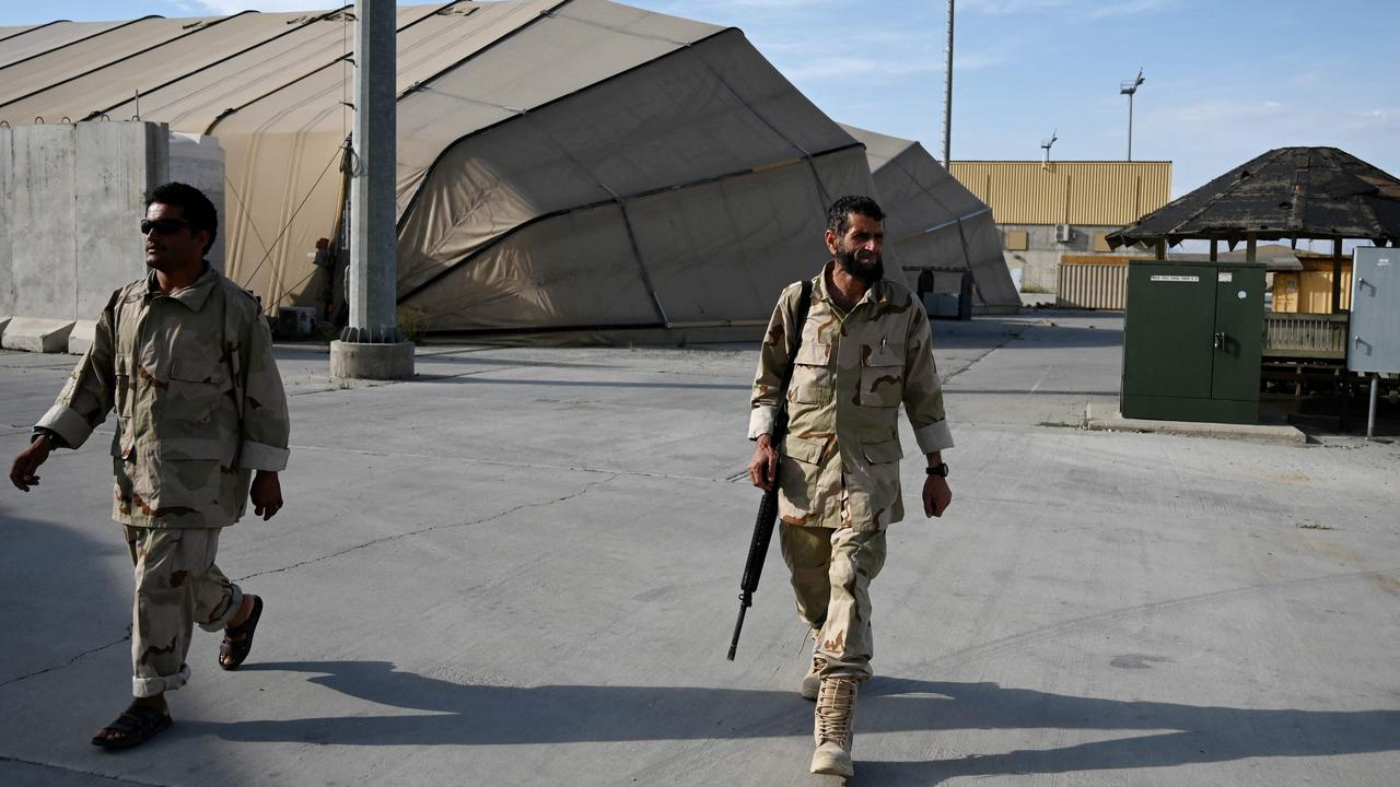 Afghan National Army soldiers walking inside the base. Picture: Wakil Kohsar/AFP