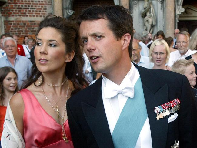 Mary Donaldson hangs off the arm of then-boyfriend Crown Prince Frederik at an event in 2002. Picture: AFP Photo/Scanpix/Keld Navntoft