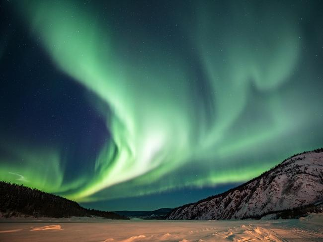 WITNESS THE AURORA BOREALIS IN WHITEHORSE, YUKON Also known as the Northern Lights, this mesmerising spectacle can be seen in many parts of Canada, thanks to a cosmic collision between particles released from the sun and the Earth's atmosphere. But the best place to see ribbons of green, blue, red and purple dancing across the sky is in the Yukon, thanks to especially long, dark and clear nights between January and April.