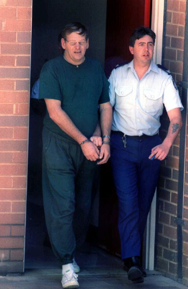 Arthurell is led from a court after being charged with murdering his fiancee, Venet Raylee Mulhall. Picture: Marc Vignes