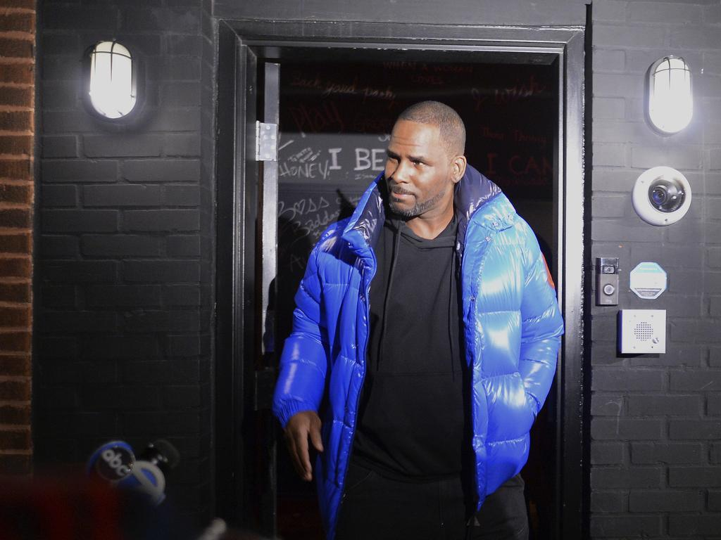 Musician R. Kelly leaves his Chicago studio on his way to surrender to police. Picture: AP