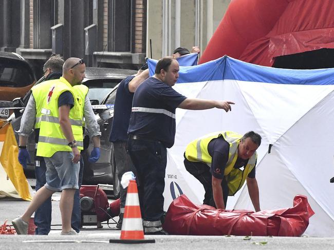 Forensic police work at the scene of a shooting. Picture: AP Photo/Geert Vanden Wijngaert