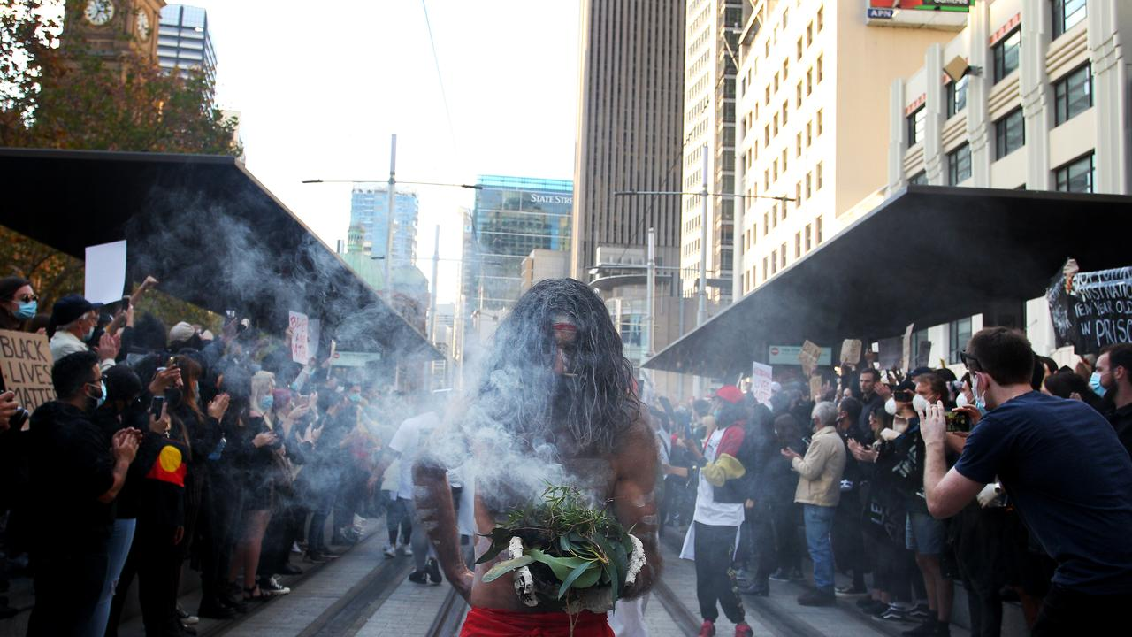 Aboriginal elders conduct a traditional smoking ceremony at Town Hall during a 'Black Lives Matter' protest march in Sydney, Australia. Lisa Maree Williams/Getty Images