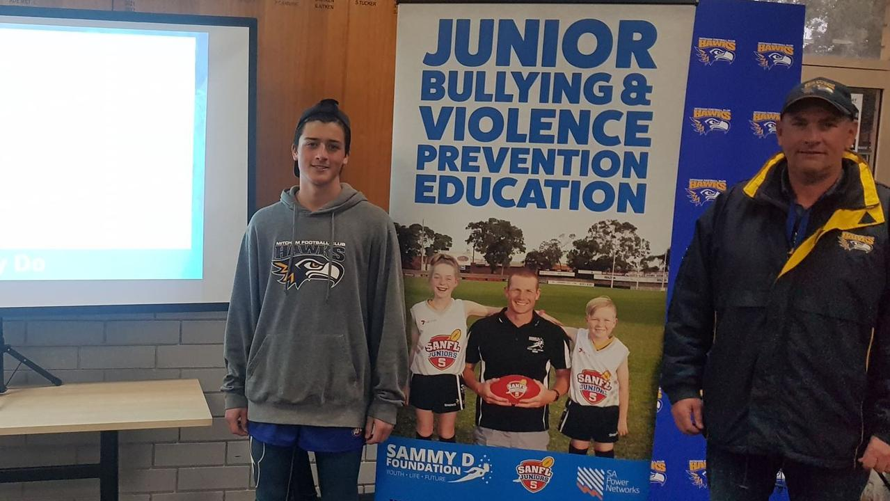 Mitcham Hawks junior football director Steve Twelftree with young player Liam ahead of a Sammy D Foundation presentation this week. Picture Supplied