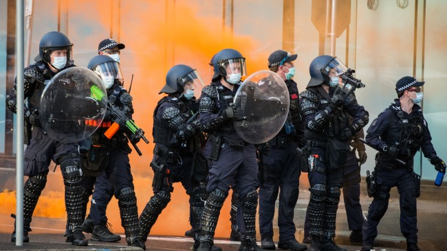 Flares were lit late in the afternoon with riot police brought in to calm the situation. Picture: Getty Images