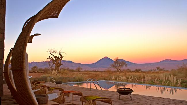 """35/41Where to stay in the Atacama Desert? Tierra Atacama - Chile Go sustainable at this desert stay, high up in the northern Chile desert, overlookingthe Atacama Desert and Licancabur Volcano. The lodge itself was formulated with an eco-friendly design, with reused water in its garden, local astronomy buffs that educate guests on """"the Andean tradition of the stars"""" and energy use that is powered by solar panels. If you need extra relaxation in your life, guests can stop by the Tierra Atacama spa for a taste of local beauty treatments, al fresco bath tubs and outdoor pool. All in all, it's one of Escape's favourite places to stay in Souith America. Picture: Supplied"""