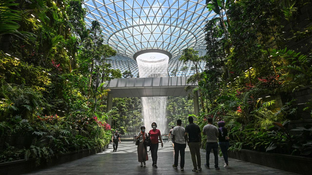 Travellers will need to have four Covid-19 tests, including one at Changi airport on arrival into Singapore. Picture: Roslan Rahman/AFP