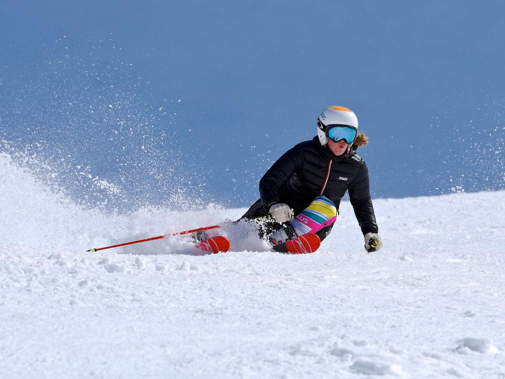 Falls Creek enters the School Holidays period with an enticing 174cm snow base. Mild temperatures are giving away to snowfalls later in the weekend as a cold front sweeps the state. The resort has extended the snow season to October 8th with the epic snowfalls this snow season. Local Alpine Racer Lily Tomkinson 20, makes a slashing ski turn at Falls Creek today.